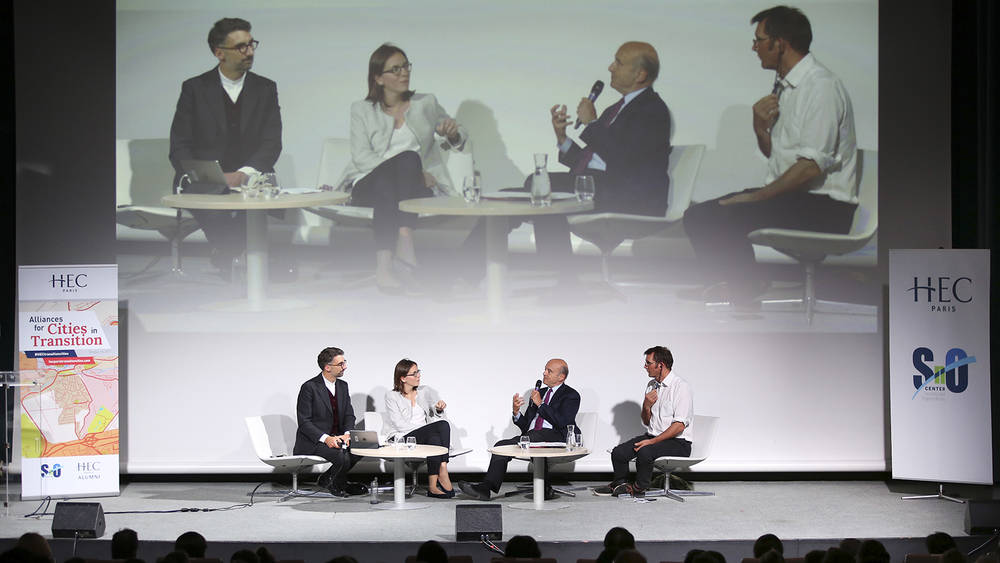 Adjunct Professor Julien Dossier, Essonne's Deputy Amélie de Montchalin, Former French Prime Minister Alain Juppé, and Co-founder of Transition Network Rob Hopkins at the plenary conference at HEC Campus.