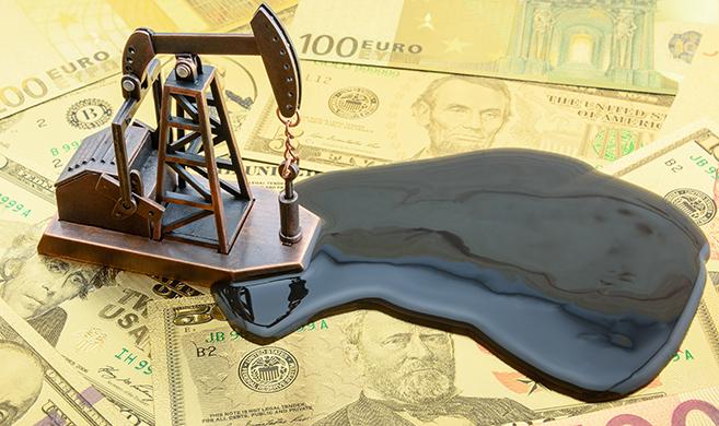 oil on money William W. Potter-AdobeStock