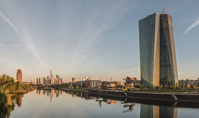Seat of the European Central Bank and Frankfurt Skyline at dawn