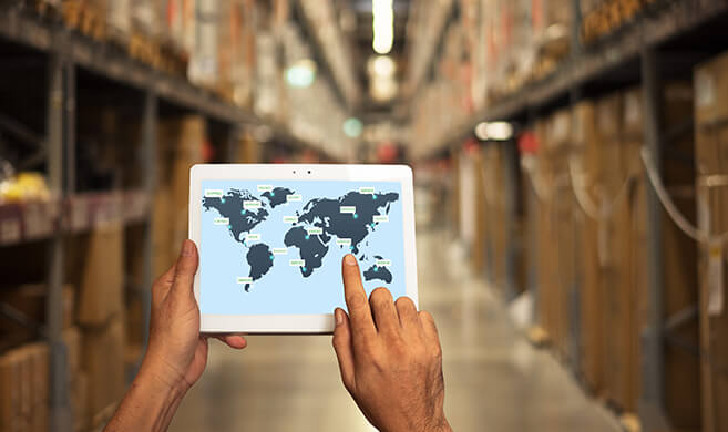 worker looking at the world map on a tablet