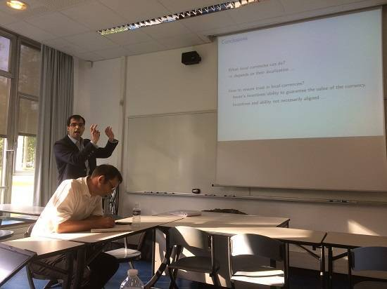 HEC Assistant Professor Eric Mengus leading a workshop on local currency in Les Mureaux with Rob Hopkins taking notes