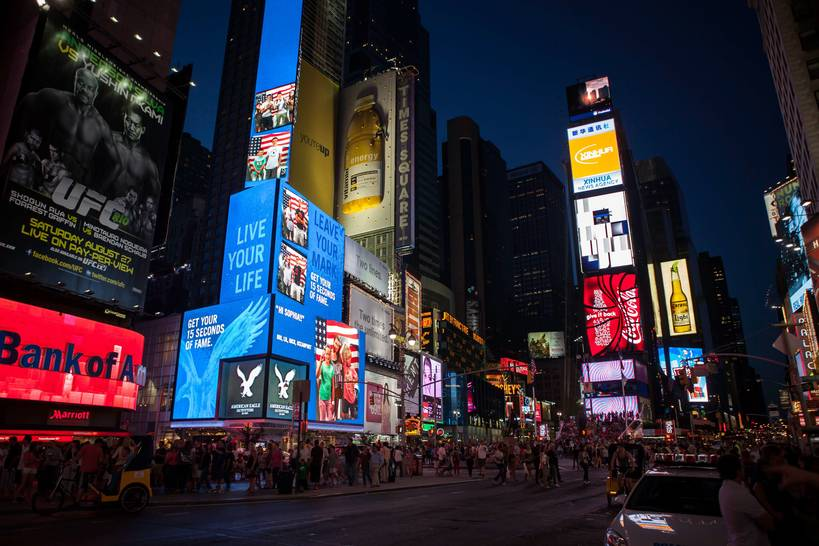 time square in New York by night, Reno Laithienne on Unsplash