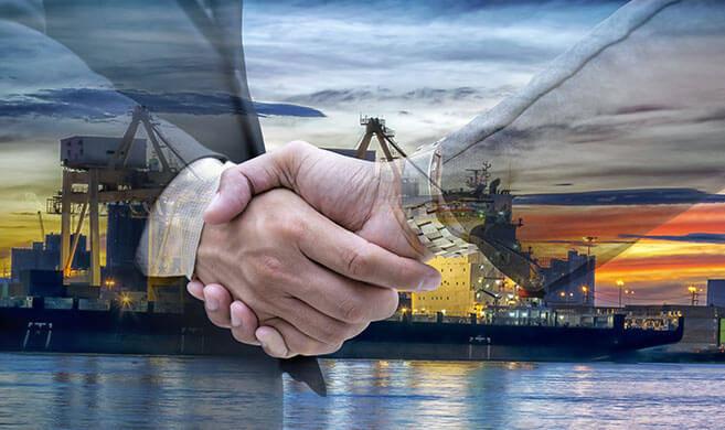 handshake in front of an oil refinery - jittawit.21-AdobeStock