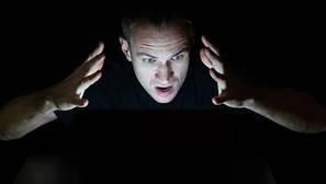 man angry at a computer