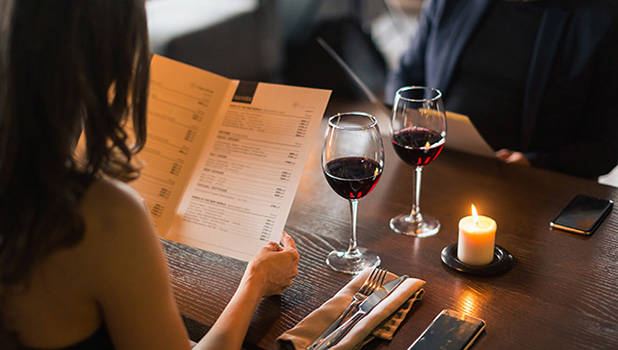 couple holding a menu at the restaurant vignette