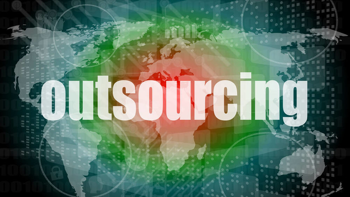 """""""outsourcing"""" word on a world map"""