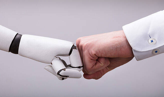 robot and human hands together