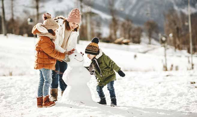 mom and kids playing in the snow