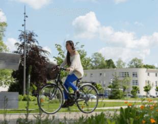 Girl on bike HEC Paris Square