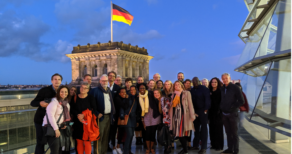 Exed participants in from of Berlin Parliament